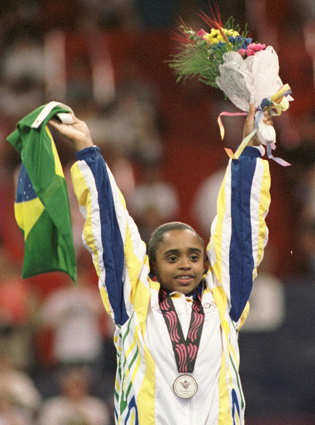 Perfil Atleta do Mês: Daiane dos Santos/vidas negras uma vitoria leva a outra noticias mulheres no esporte mulheres negras decada afro